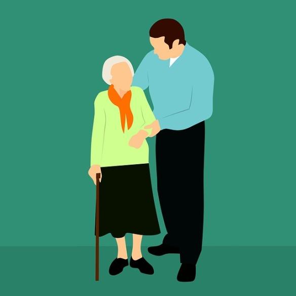 worker helps elderly lady