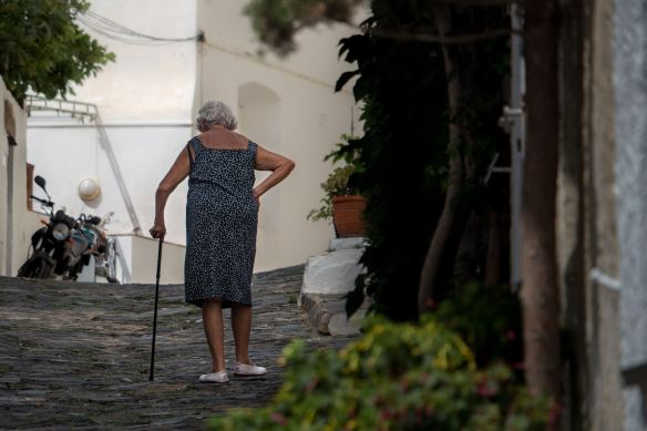 david-monje-lady with walking stick
